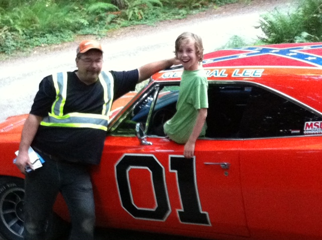 Canadian Rebel redneck Darcy Vickery shows off his General Lee to my  son, Michael.