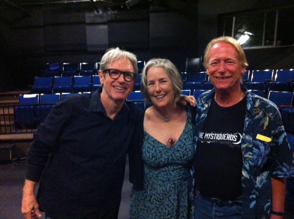 Sam Baker (left) with his friends Penny Edwards and Trey Palmer at the Columbia River Center for the Arts Theater in Hood River, Ore., Aug. 24, 2014.