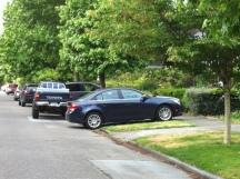 blue car blocking sidewalk