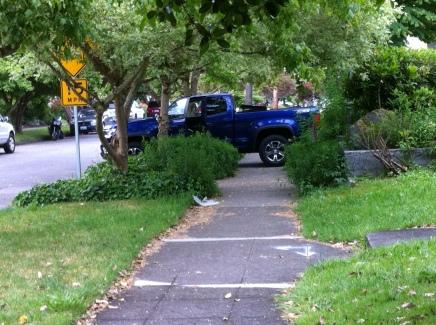blue truck blocking driveway